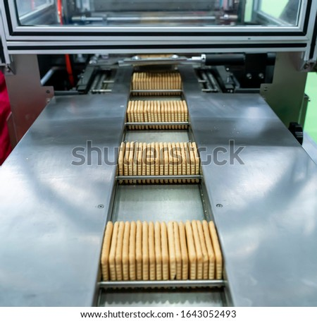 automate robot conveyor in Production of biscuits in a manufacture factory for the food industry #1643052493