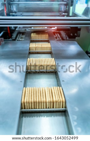 automate robot conveyor in Production of biscuits in a manufacture factory for the food industry #1643052499