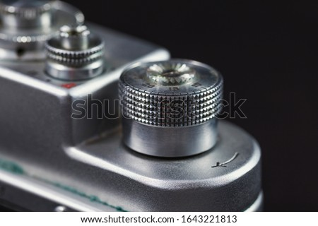 Detail of an old camera - controller, closeup. Retro camera in scratches and dust from a private collection. #1643221813