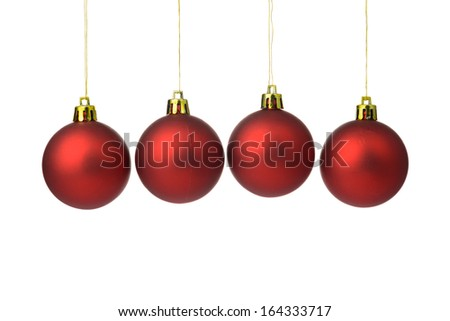 Red Christmas balls hanging on string over white background #164333717