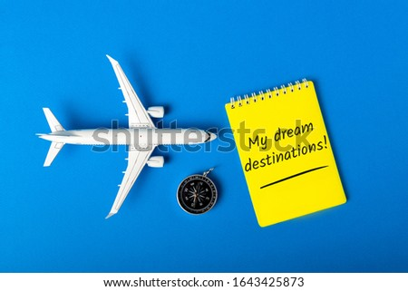 My dream destinations - checklist with toy plane and compas. 2020 Summer travel concept #1643425873