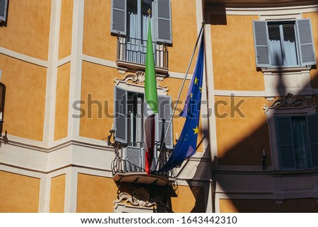 Flag of the European Union. The flag of the European Union hangs on the building. #1643442310