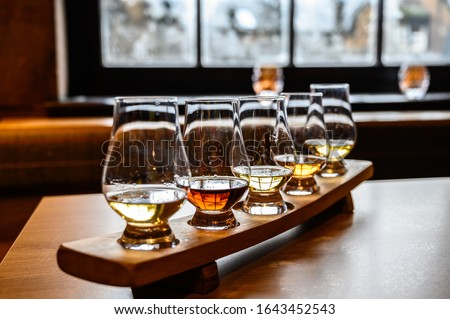 Collection of Scottish whisky, tasting glasses with variety of single malts or blended whiskey spirits on distillery tour in Scotland, UK #1643452543