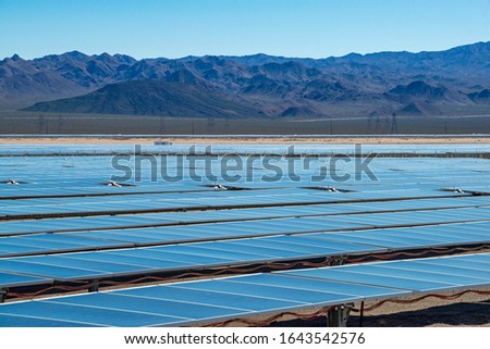 USA, Nevada, Clark County, Eldorado Valley, Boulder City. An industrial scale solar power plant facility generating renewable energy with a farm of photovoltaic panels that generate electricity #1643542576