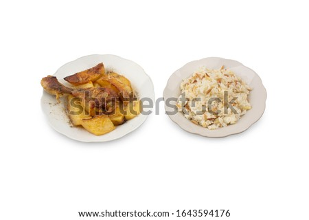Rice and chicken dish. Chicken dish with potatoes. Rice dish. Turkish foods. In two separate porcelain dishes. Shooting isolated on white background. Studio shoot. #1643594176