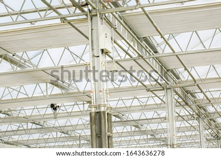 Close-up of steel structure greenhouse structure #1643636278