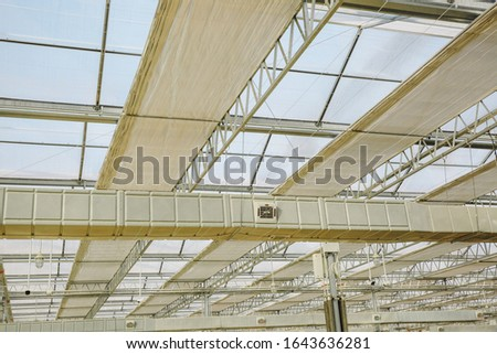 Close-up of steel structure greenhouse structure #1643636281