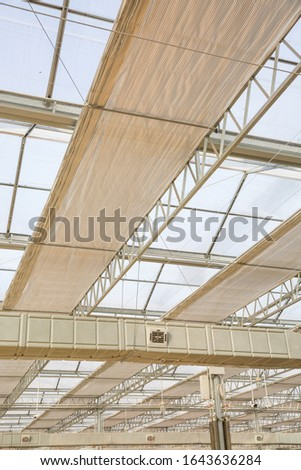 Close-up of steel structure greenhouse structure #1643636284