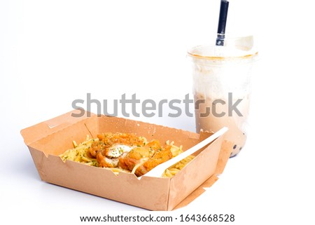 A picture of spaghetti carbonara with fried chicken and fresh milk boba tea.