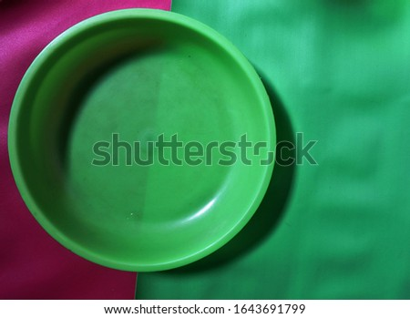 photo of plastic plate with pink and green background  #1643691799