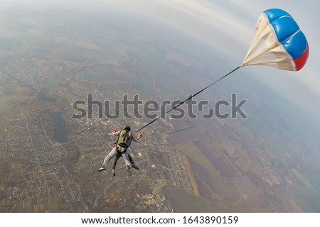 Skydiving tandem parachute fly with a small pilot chute #1643890159