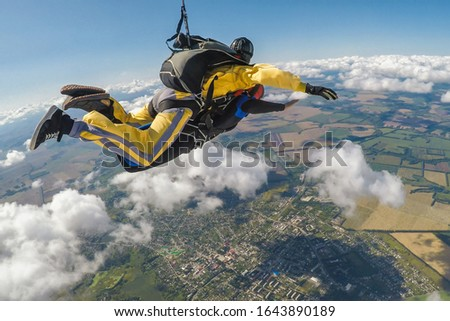 Skydive tandem free falling above the clouds #1643890189