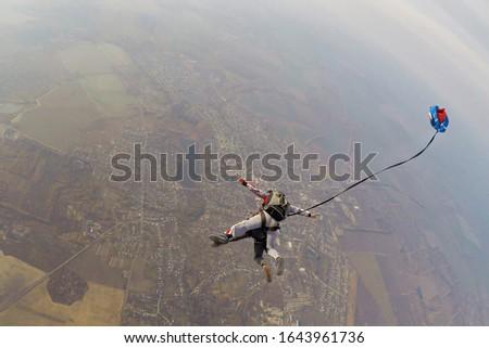 Skydiving tandem parachute deploying the small pilot chute #1643961736