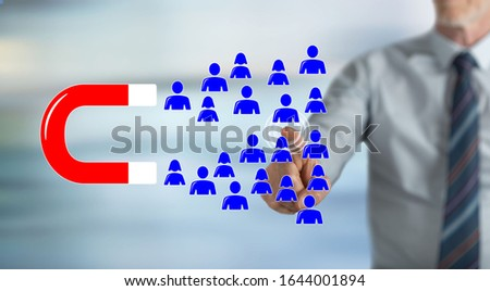 Man touching a customer attraction concept on a touch screen with his finger #1644001894