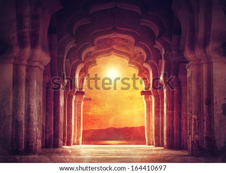 Old ruined arch in ancient temple at sunset in India Royalty-Free Stock Photo #164410697