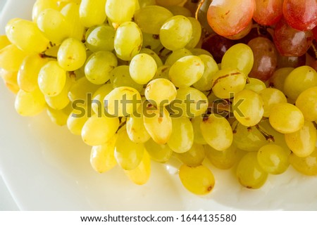 Grapes can be eaten fresh as table grapes or they can be used for making wine, jam, juice, jelly, grape seed extract, raisins, vinegar, and grape seed oil. Grapes are a non-climacteric type of fruit #1644135580