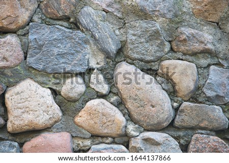 Texture of a stone wall. Old castle stone wall texture background. Stone wall as a background or texture. Part of a stone wall, for background or texture. Royalty-Free Stock Photo #1644137866
