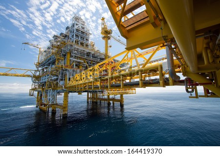Oil and gas platform in the gulf or the sea, The world energy, Offshore oil and rig construction. Royalty-Free Stock Photo #164419370