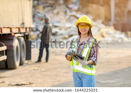 Stock keeper girl Currently using the product tablet Before exporting for sale #1644225031