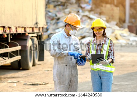 Young women, caretakers of goods and young male workers Currently using the product tablet Before exporting for sale #1644240580