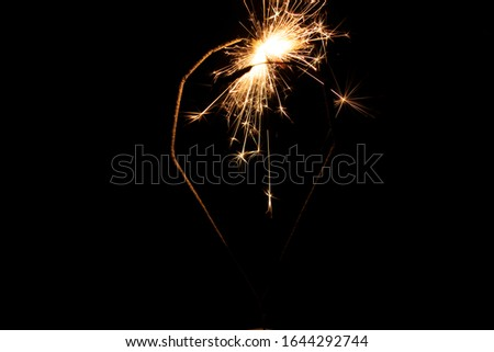 Sparklers in the dark. Sparks with fire in hands on a stick. #1644292744