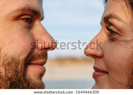 Faces of a guy and a girl. Guy and girl look at each other #1644466300