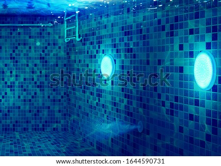 Every Swimming pool needs lighting. Using Underwater LED Light, swimming pool become cool place to relax and swim activity. This digital image convey all the swimming pool business needs for promotion #1644590731