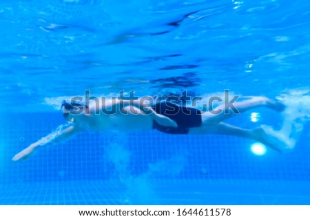 Photo blur. men swim in a freestyle swimming style that is standard swimming.