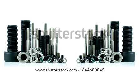 Metal bolts and nuts on white background. Fasteners equipment. Hardware tools. Stud bolt, hex nuts, and hex head bolts in workshop. Threaded fastener use in automotive engineering. Hexagonal bolt. Royalty-Free Stock Photo #1644680845