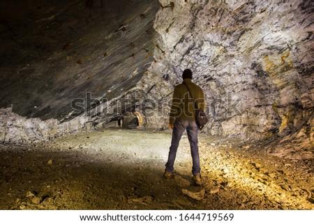 Man miner at undeground quartz mine tunnel #1644719569