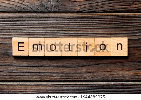 emotion word written on wood block. emotion text on table, concept. #1644889075