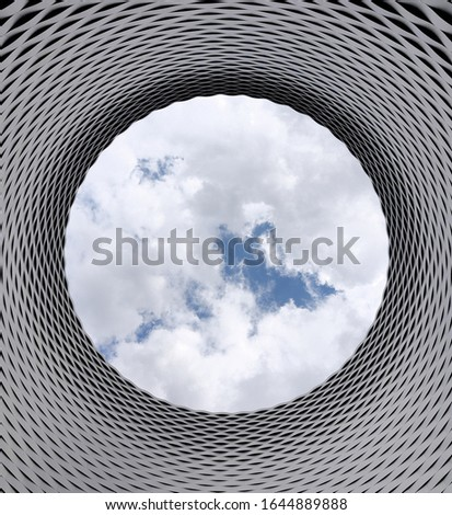 Low angle photography of grey and black tunnel overlooking white cloud and blue sky #1644889888
