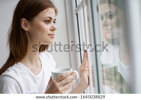 Woman daydreaming looks out the window sadness rest lifestyle lifestyle interior #1645038829
