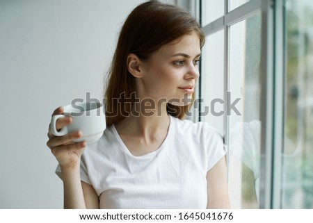 Woman daydreaming looks out the window sadness rest lifestyle lifestyle interior #1645041676