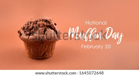National Muffin Day. Chocolate muffin isolated on a brown background. One delicious muffin images. Muffin Day Poster, February 20 #1645072648