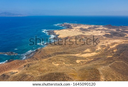 Aerial view of the coast of the island of Lobos, off the island of Fuerteventura in the Canary Islands. October 2019