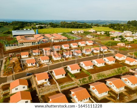 Aerial view of a housing estate (popular houses) in Paraná, Brazil. Royalty-Free Stock Photo #1645111228