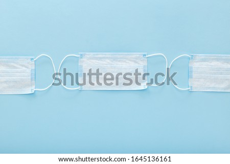 Medical mask, Medical protective masks on blue background. Disposable surgical face mask cover the mouth and nose. Healthcare and medical concept. #1645136161