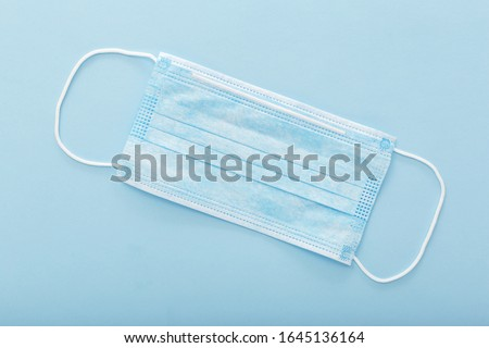 Medical mask, Medical protective mask on blue background. Disposable surgical face mask cover the mouth and nose. Healthcare and medical concept. #1645136164