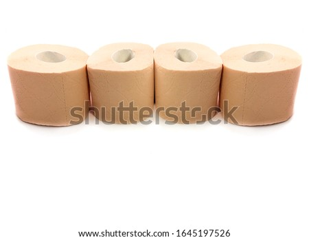 Toilet paper isolated on a white background. The composition of the rolls of toilet paper. Toilet paper with a pattern. Set of toilet paper. #1645197526