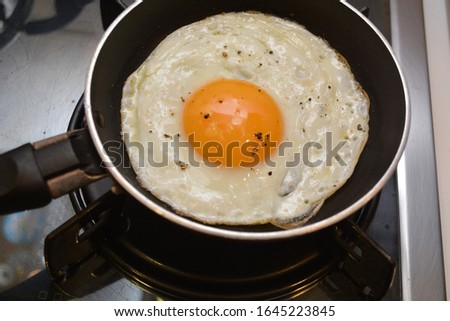 egg cooked in a pan breakfast food on wooden background #1645223845