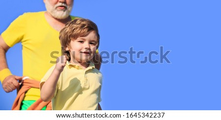 Sport for kids, active child running. Kid run on outdoor. Jogging for kid. Child running in stadium. Father and son play sports and run. Healthy sport activity for children. Copy space. #1645342237