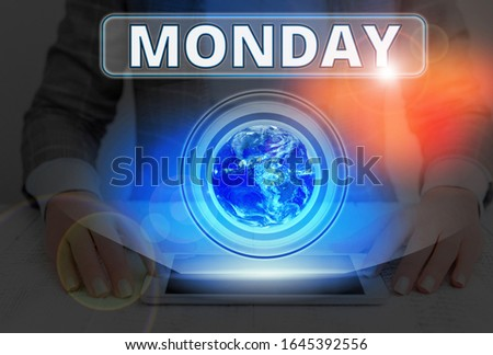 Text sign showing Monday. Conceptual photo the day of the week after Sunday and before Tuesday Day of the Moon Elements of this image furnished by NASA.