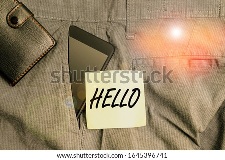 Word writing text Hello. Business concept for used as a greeting or to begin a telephone conversation Greet someone Smartphone device inside trousers front pocket with wallet and note paper. #1645396741