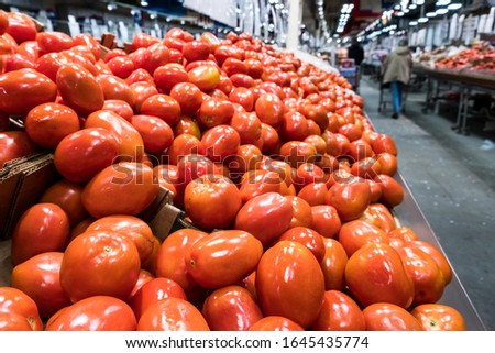 Red ripe tomatoes in a market for sale. Farmer's market. #1645435774
