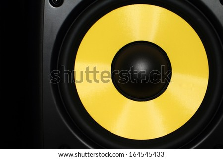 Closeup of a yellow speaker sub woofer #164545433