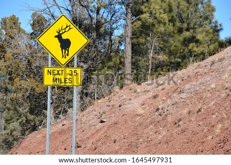 Elk Crossing Sign. Beware of Elk jaywalking across the road. Payson, Tonto National Forest. Arizona USA
