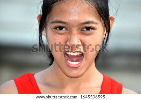 A Stressed Youthful Filipina Female Juvenile #1645506595