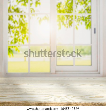 blur wooden table in the kitchen on the window background in the morning.  Royalty-Free Stock Photo #1645542529