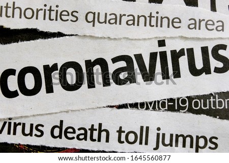 Novel coronavirus breaking news headline clippings from various newspapers reporting on the deadly disease, macro view. Concept for global coverage on severity of Covid-19 or 2019-ncov virus. #1645560877